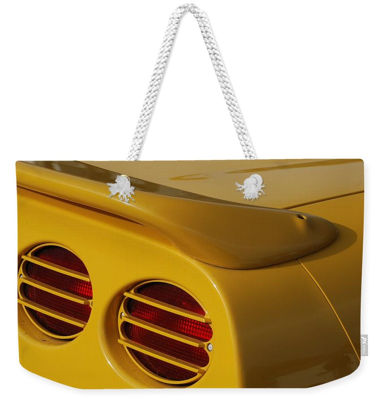 Corvette Weekender Tote Bag featuring the photograph Yellow Vette Lights by Rob Hans