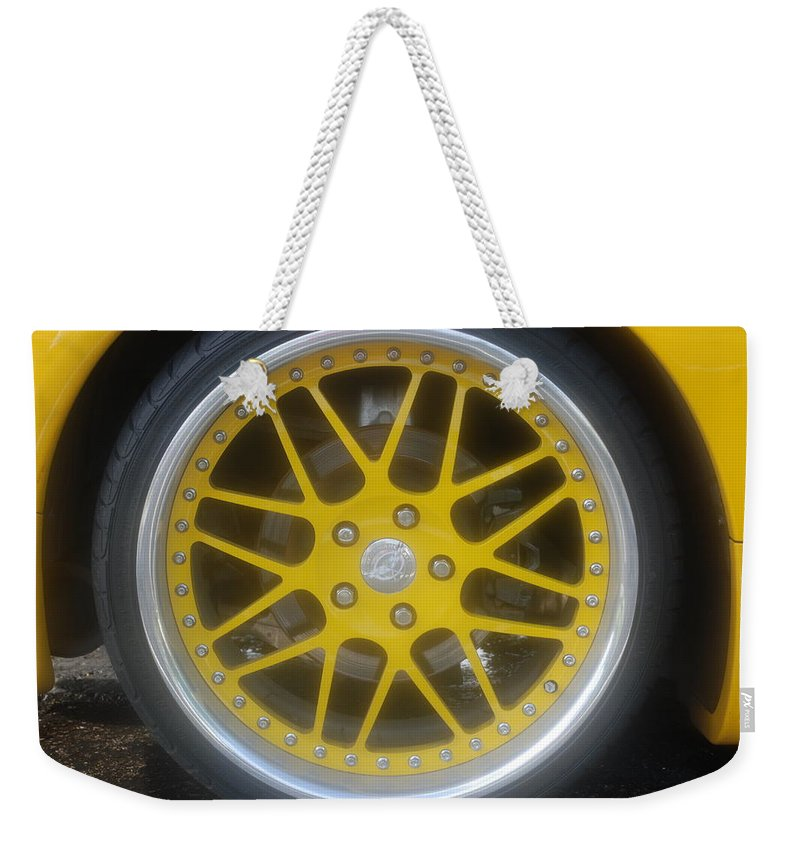 Corvette Weekender Tote Bag featuring the photograph Yellow Vette Wheel by Rob Hans