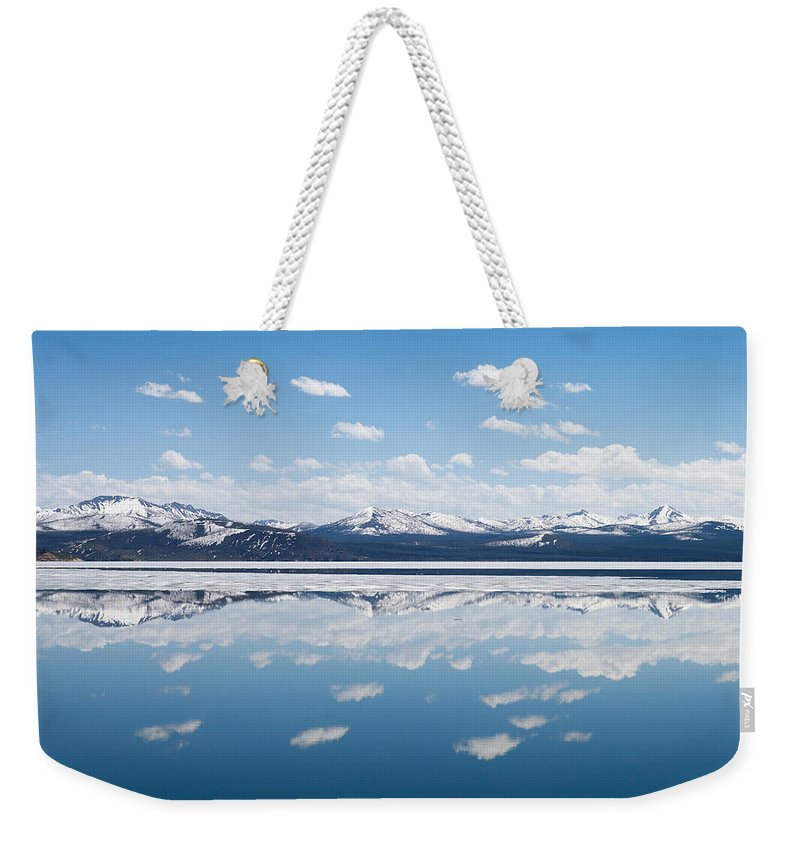 Yellowstone National Park Weekender Tote Bag featuring the photograph Yellowstone Lake Reflection by Max Waugh