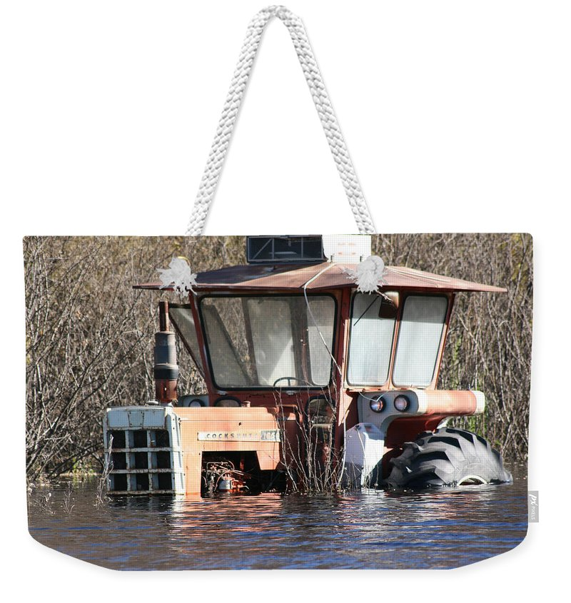 Flood Regina Sk Canada Flooding Flooded Farm Tractor Trees Grass Wrecked Loss Weekender Tote Bag featuring the photograph You Go Get The Tractor by Andrea Lawrence