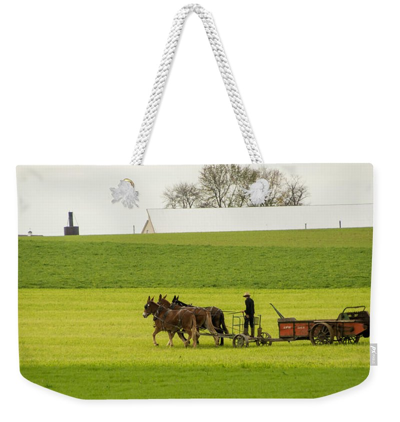 Amish Weekender Tote Bag featuring the photograph Young Amish Farmer by Jennifer Wick