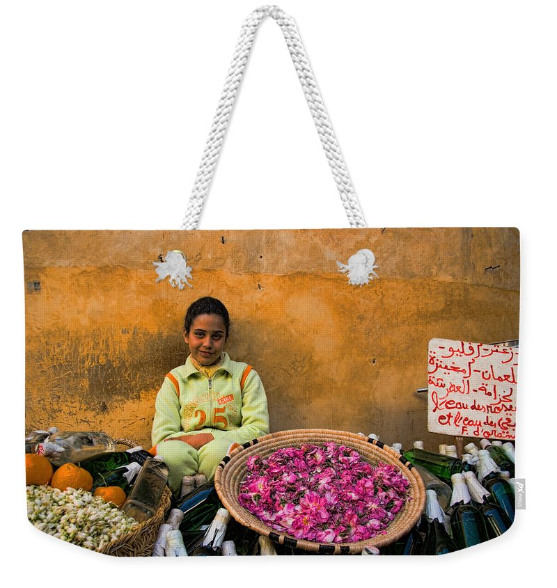 Young Weekender Tote Bag featuring the photograph Young Girl Selling Rose Petals In The Medina Of Fes Morroco by David Smith