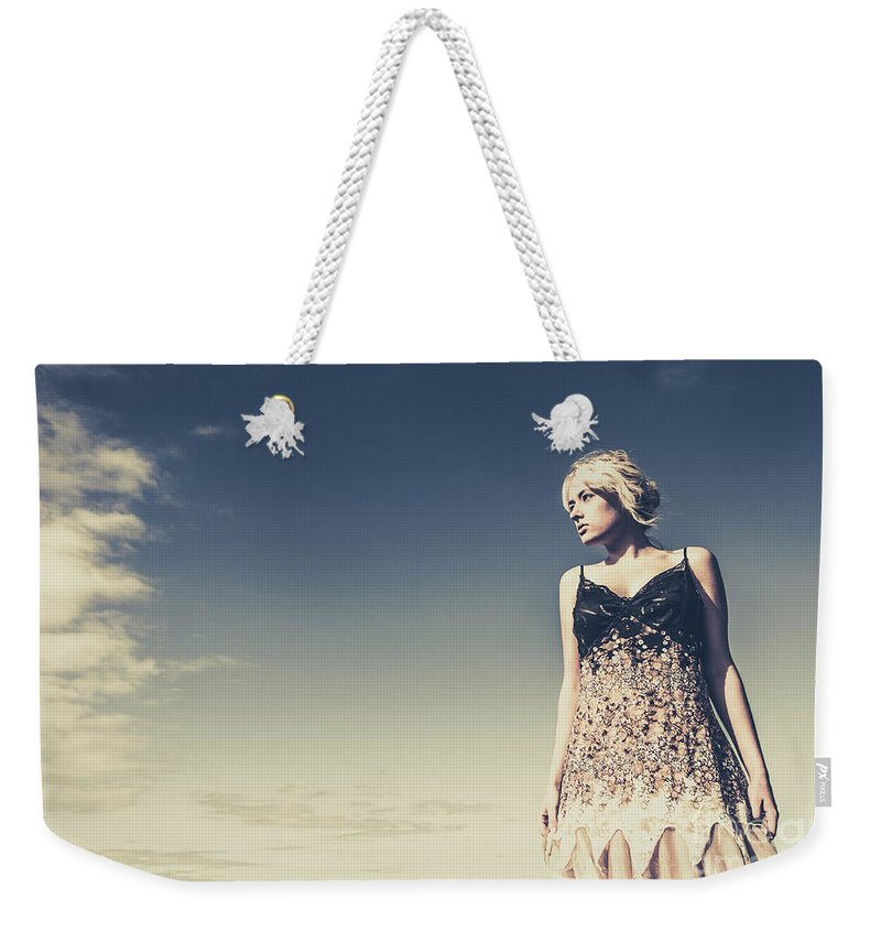Female Weekender Tote Bag featuring the photograph Young Woman Standing On The Beach by Jorgo Photography - Wall Art Gallery