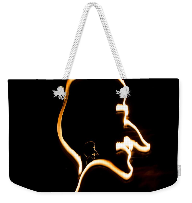Fire Weekender Tote Bag featuring the photograph Your Inner Self by Marnie Patchett