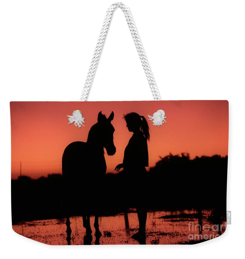Silhouette Weekender Tote Bag featuring the photograph Youth by Jim And Emily Bush