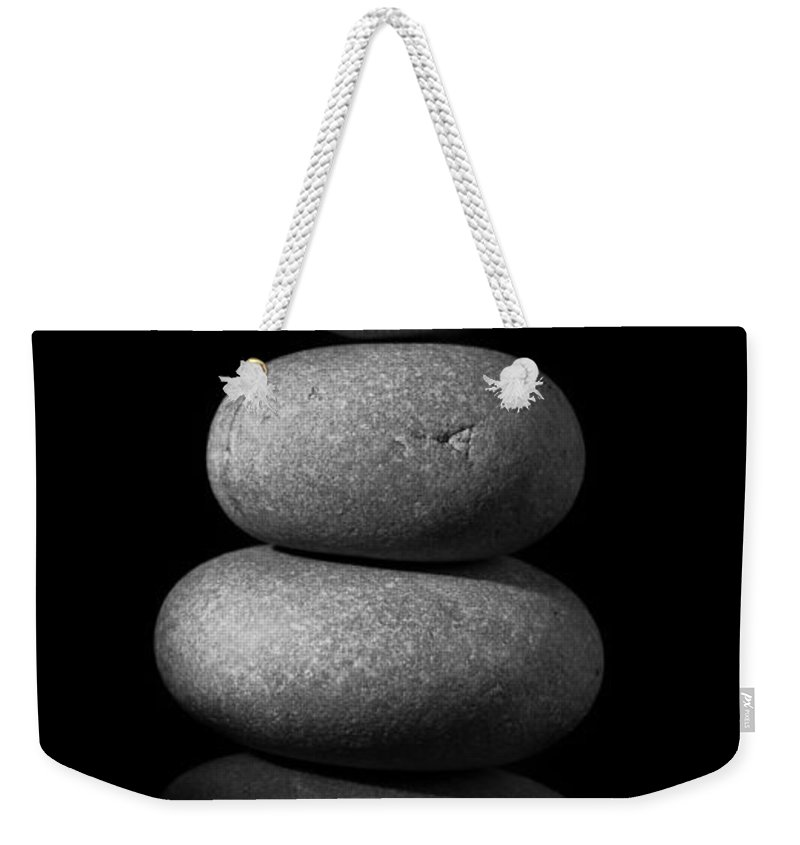 Zen Stones Weekender Tote Bag featuring the photograph Zen Stones In The Dark II by Marco Oliveira