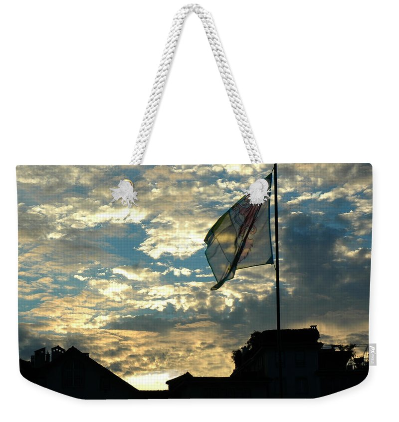 Europe Weekender Tote Bag featuring the photograph Zurich Griffin Flag At Sunset by Ginger Wakem