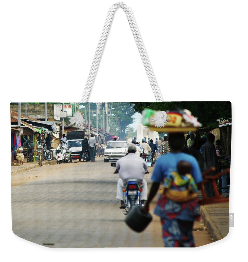 Trading Weekender Tote Bag featuring the photograph African Street Scene by Peeterv