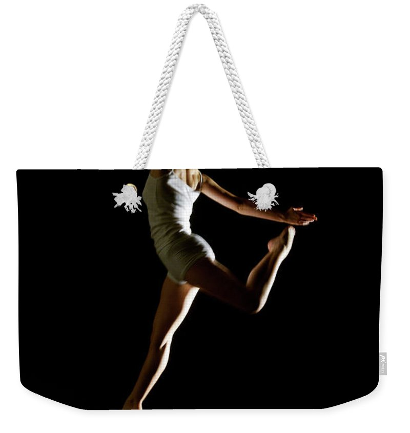 Ballet Dancer Weekender Tote Bag featuring the photograph Ballet And Contemporary Dancers by John Rensten