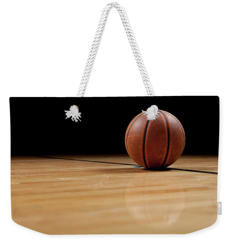Ball Weekender Tote Bag featuring the photograph Basketball by Garymilner