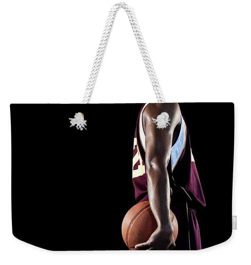 Three Quarter Length Weekender Tote Bag featuring the photograph Basketball Player by Patrik Giardino