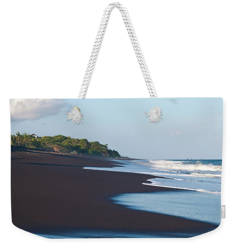 Long Weekender Tote Bag featuring the photograph Black Sand Beach by Davorlovincic