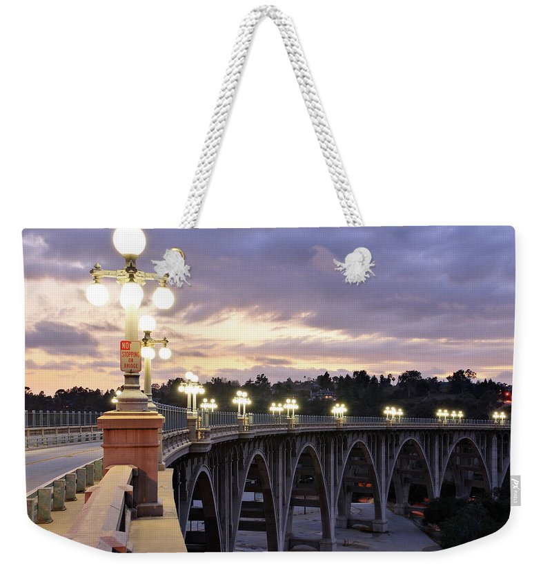 Arch Weekender Tote Bag featuring the photograph Bridge At Sunset by S. Greg Panosian