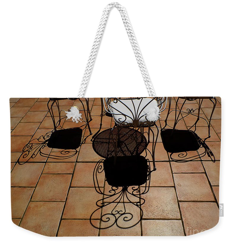 Chairs Weekender Tote Bag featuring the photograph Chairs And Shadows by Mike Nellums
