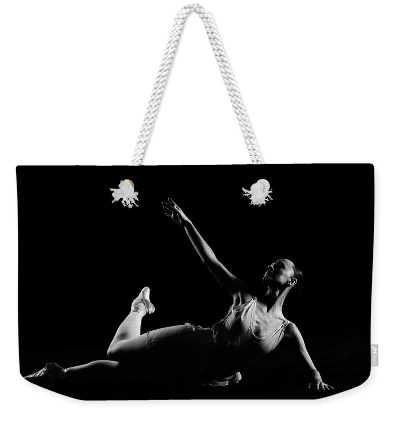 Expertise Weekender Tote Bag featuring the photograph Classical Dancer by Oleg66