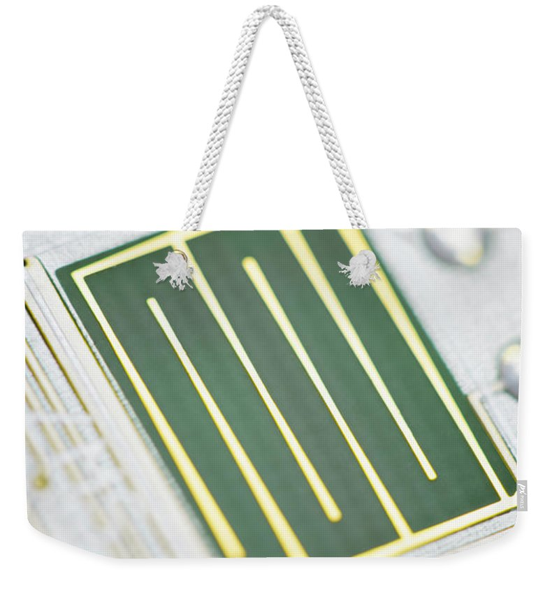 Tin Weekender Tote Bag featuring the photograph Close-up Of A Circuit Board by Nicholas Rigg