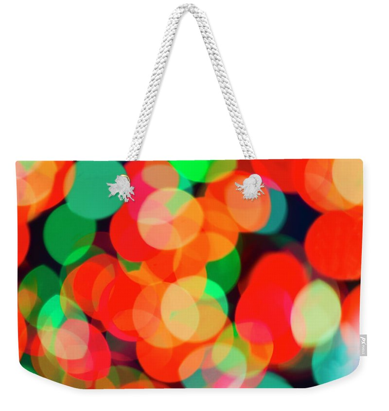 Holiday Weekender Tote Bag featuring the photograph Defocused Lights by Tetra Images