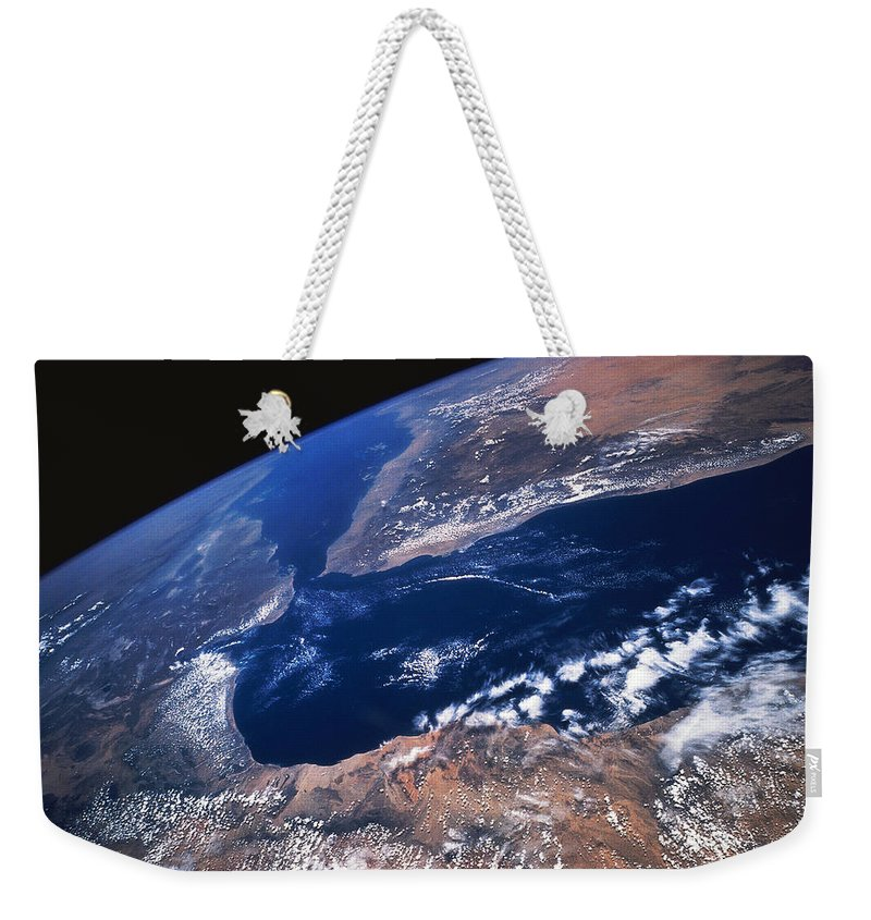 Black Background Weekender Tote Bag featuring the photograph Earth From Space by Stocktrek
