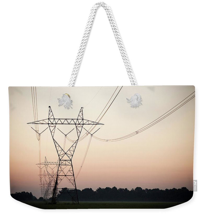 Tranquility Weekender Tote Bag featuring the photograph Electrical Power Lines Against The by Wesley Hitt