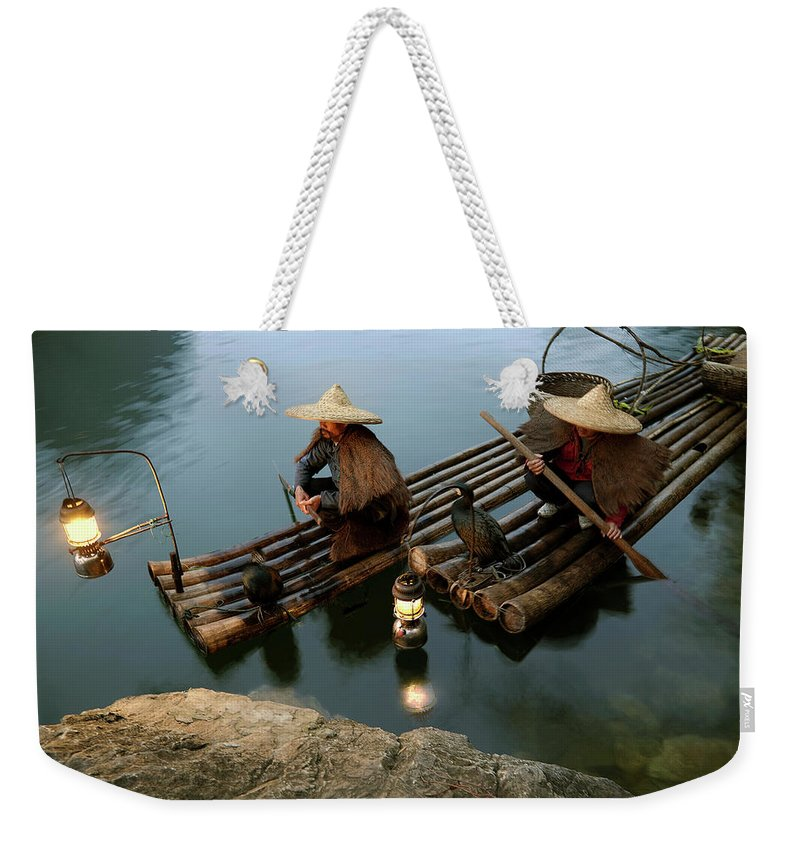Yangshuo Weekender Tote Bag featuring the photograph Fishing With Cormorants by Kingwu