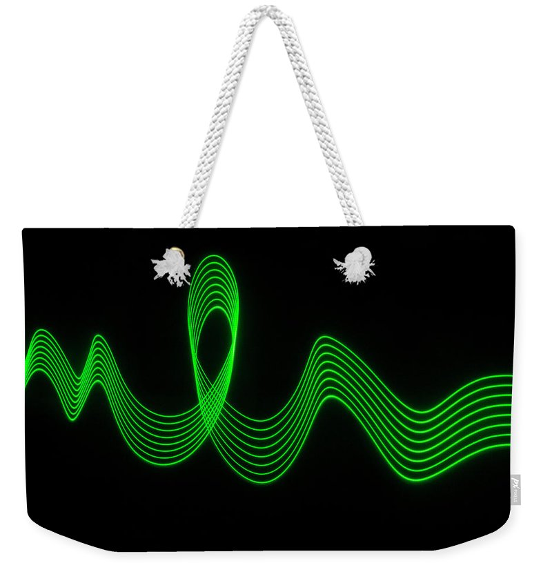 Laser Weekender Tote Bag featuring the photograph Green Abstract Coloured Lights Trails by John Rensten