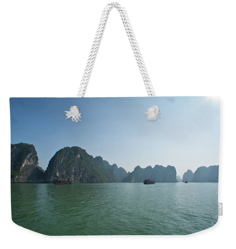 Scenics Weekender Tote Bag featuring the photograph Ha Long Bay by By Thomas Gasienica