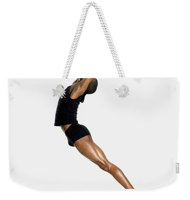 Young Men Weekender Tote Bag featuring the photograph Male Dancer Jumping by Image Source
