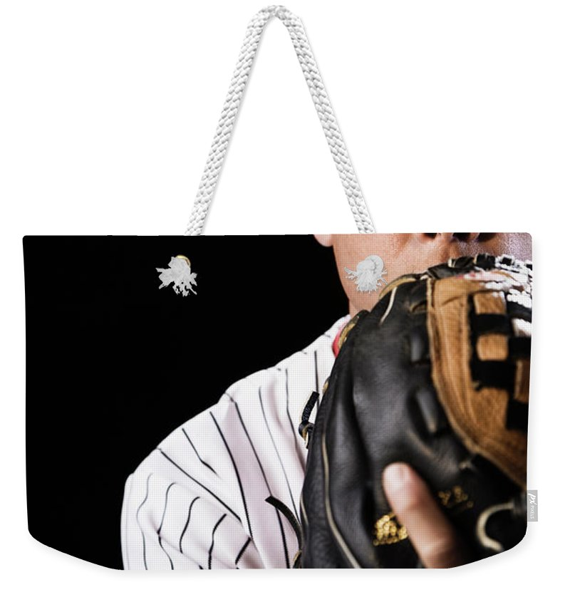 Baseball Cap Weekender Tote Bag featuring the photograph Mixed Race Baseball Player Pitching by Hill Street Studios