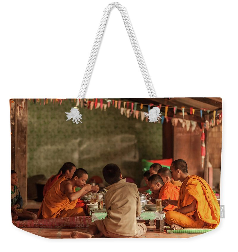 Young Men Weekender Tote Bag featuring the photograph Monks At Breakfast, Wat Monastery by Cultura Rm Exclusive/gary Latham