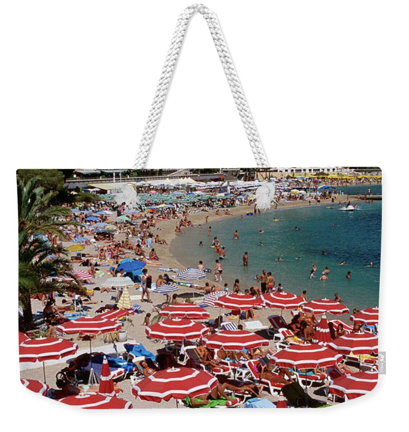 Shadow Weekender Tote Bag featuring the photograph Overhead Of Red Sun Umbrellas At by Dallas Stribley