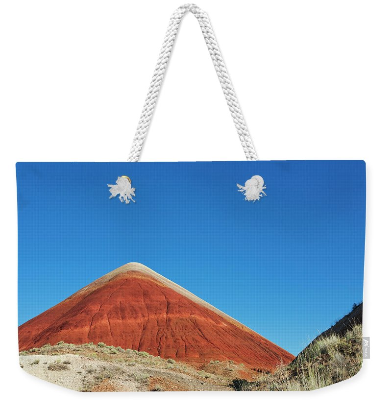 Scenics Weekender Tote Bag featuring the photograph Painted Hills Desert With Quarter Moon by Sasha Weleber