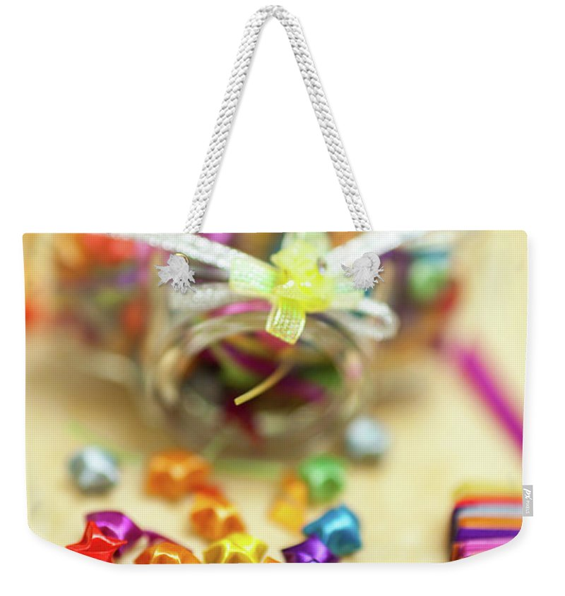 Good Luck Charm Weekender Tote Bag featuring the photograph Paper Lucky Stars, With Some Unfinished by Wilfred Y Wong