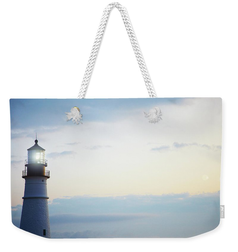Outdoors Weekender Tote Bag featuring the photograph Portland Head Lighthouse At Sunrise by Thomas Northcut