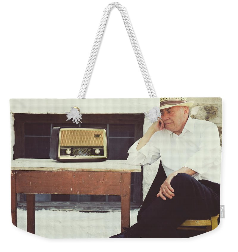 People Weekender Tote Bag featuring the photograph Portrait Of A Senior Man by Thanasis Zovoilis