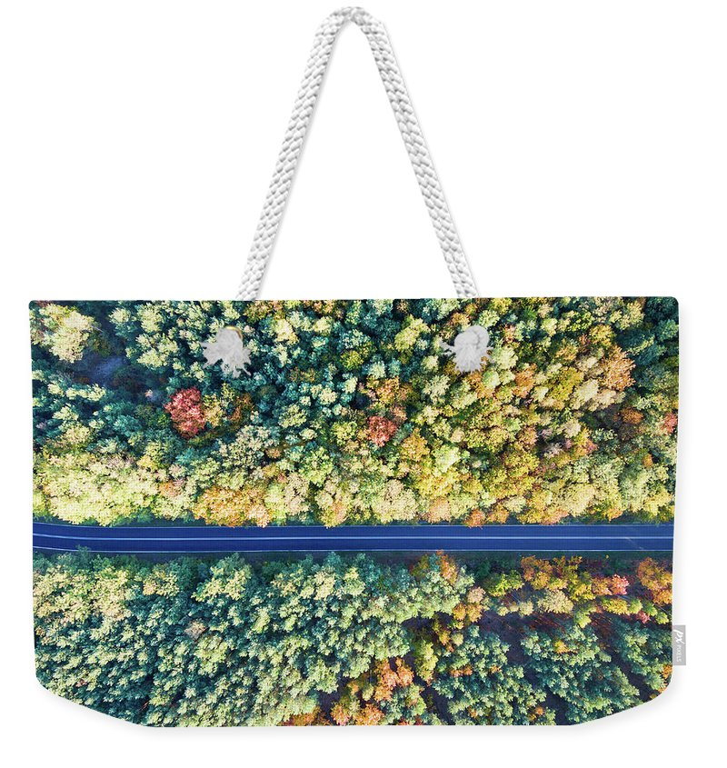 Aerial Weekender Tote Bag featuring the photograph Road Through Colorful Autumn Forest by Lukasz Szczepanski
