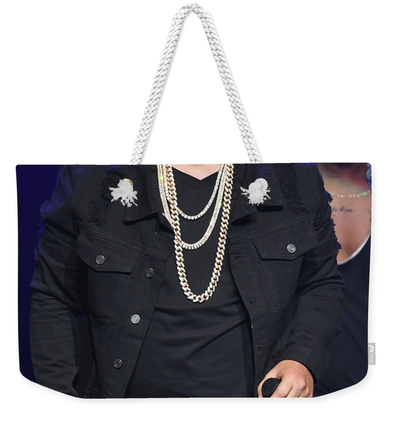 Daddy Yankee Weekender Tote Bag featuring the photograph Singer Daddy Yankee by Concert Photos
