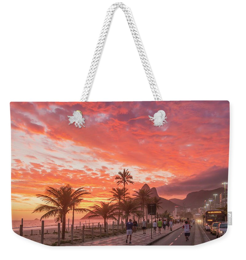 Majestic Weekender Tote Bag featuring the photograph Sunset Over Ipanema Beach by Buena Vista Images