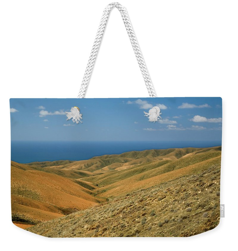 Scenics Weekender Tote Bag featuring the photograph The Barren Hills Of Western by Roel Meijer