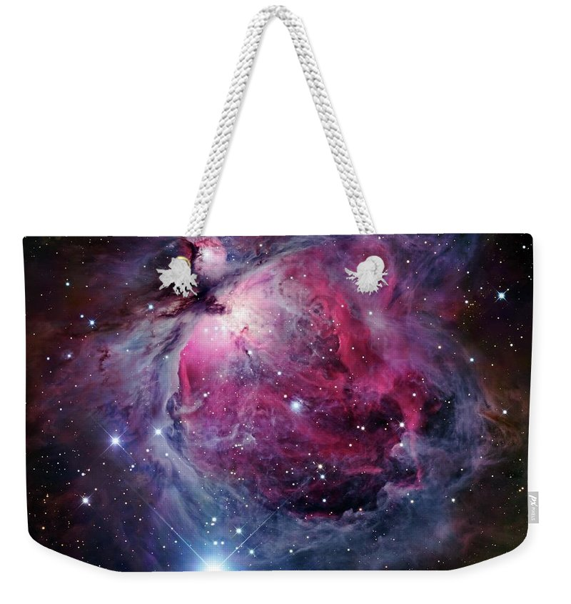 Purple Weekender Tote Bag featuring the photograph The Orion Nebula, Also Known As Messier by Stocktrek Images