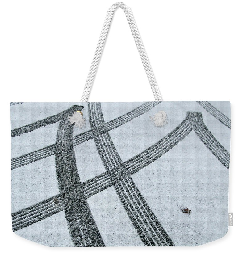 Black Color Weekender Tote Bag featuring the photograph Tire Tracks In Snow, Winter by Jerry Whaley