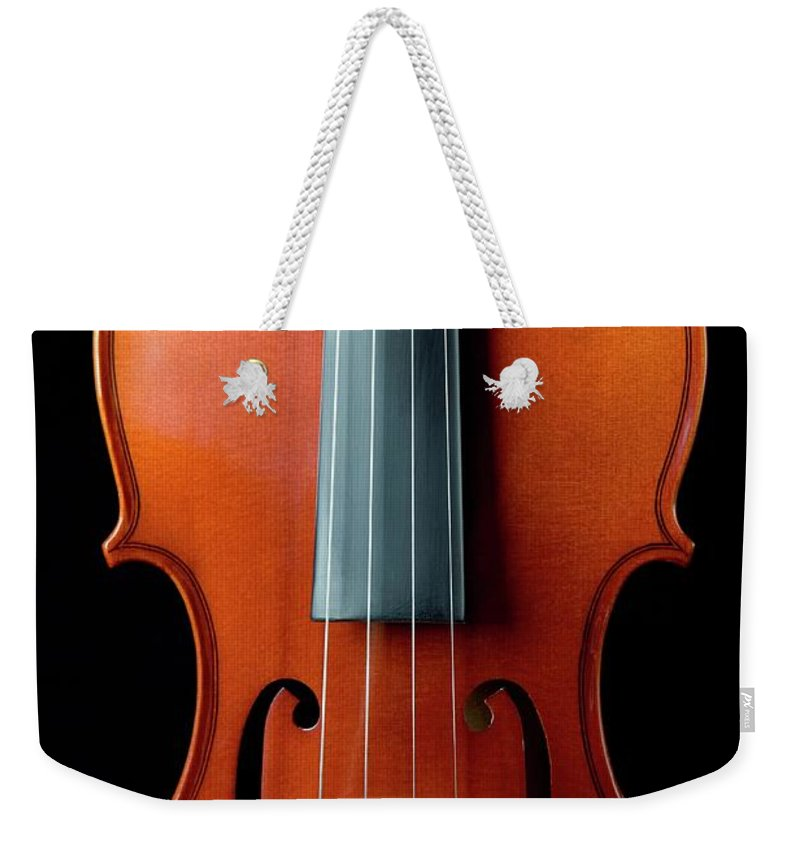 Music Weekender Tote Bag featuring the photograph Violin by Junior Gonzalez