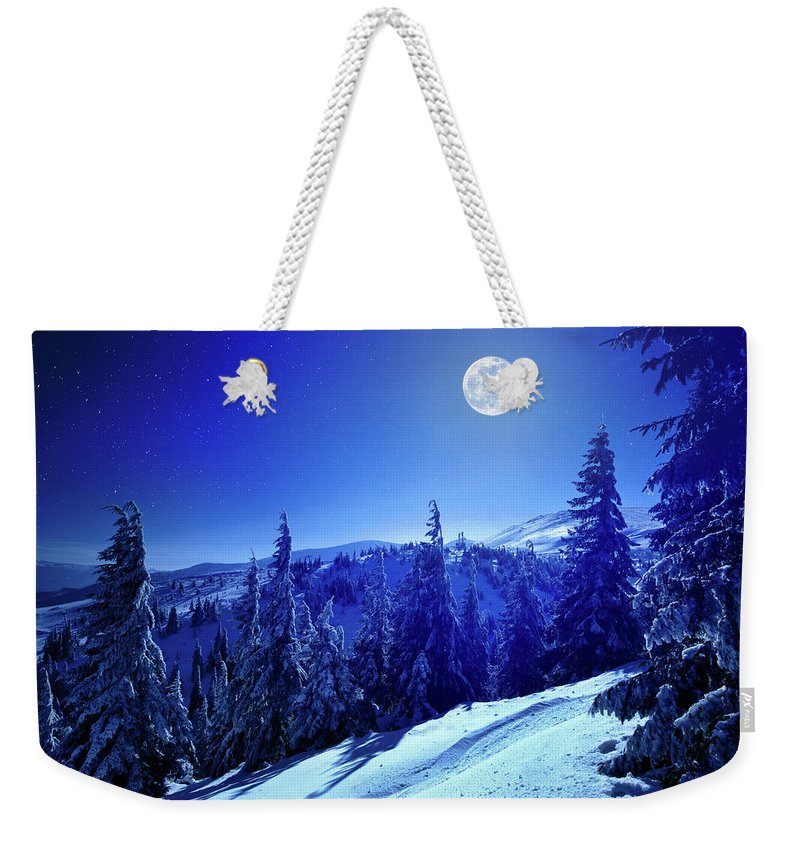Cool Attitude Weekender Tote Bag featuring the photograph Winter Moon by Yourapechkin