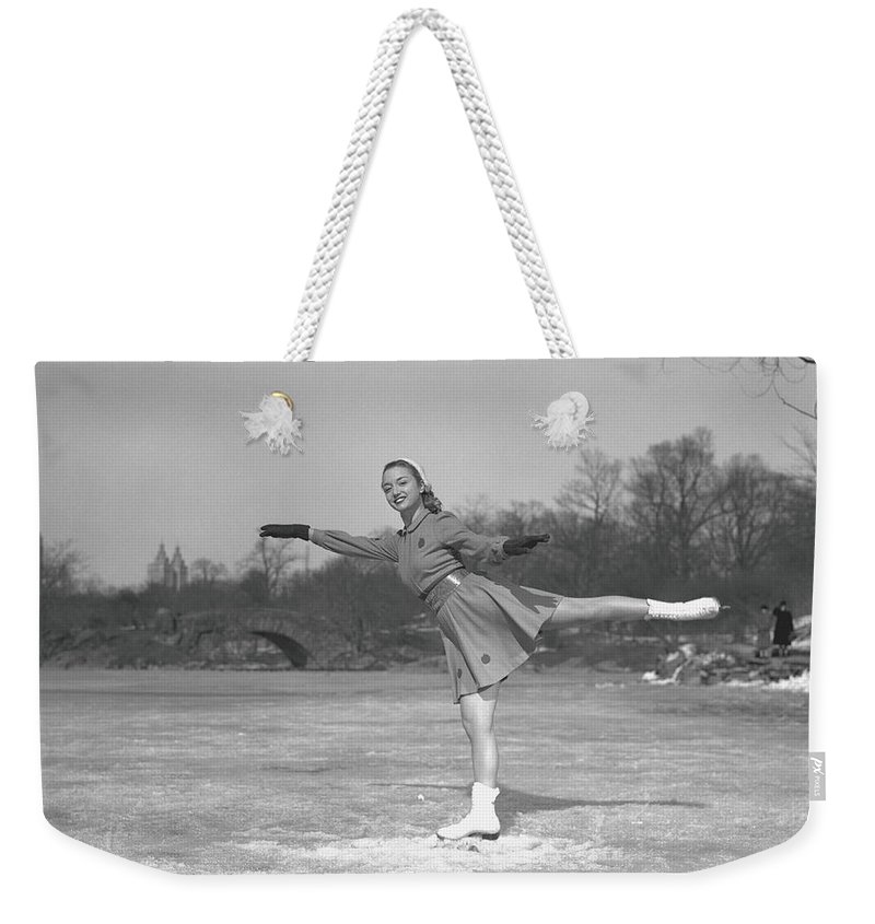 Human Arm Weekender Tote Bag featuring the photograph Woman Ice Skating Outdoors, B&w by George Marks