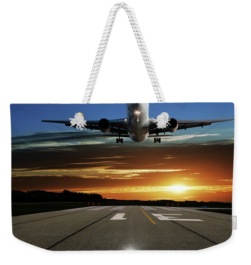 Orange Color Weekender Tote Bag featuring the photograph Xl Jet Airplane Landing At Sunset by Sharply done