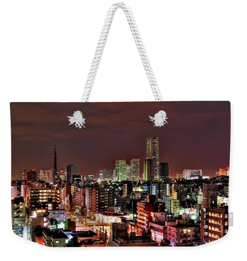 Tranquility Weekender Tote Bag featuring the photograph Yokohama Nightscape by Copyright Artem Vorobiev