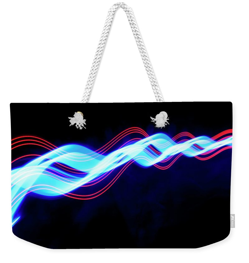 Black Background Weekender Tote Bag featuring the photograph Abstract Light Trails And Streams by John Rensten
