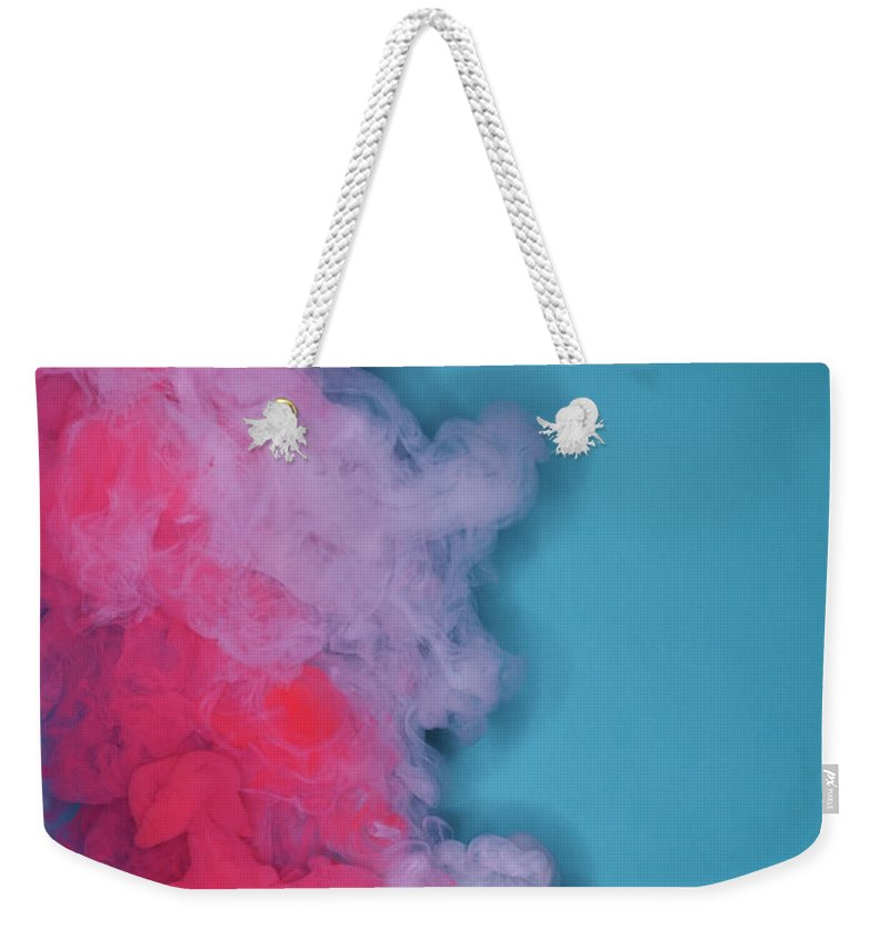 Motion Weekender Tote Bag featuring the photograph Colored Smoke by Henrik Sorensen