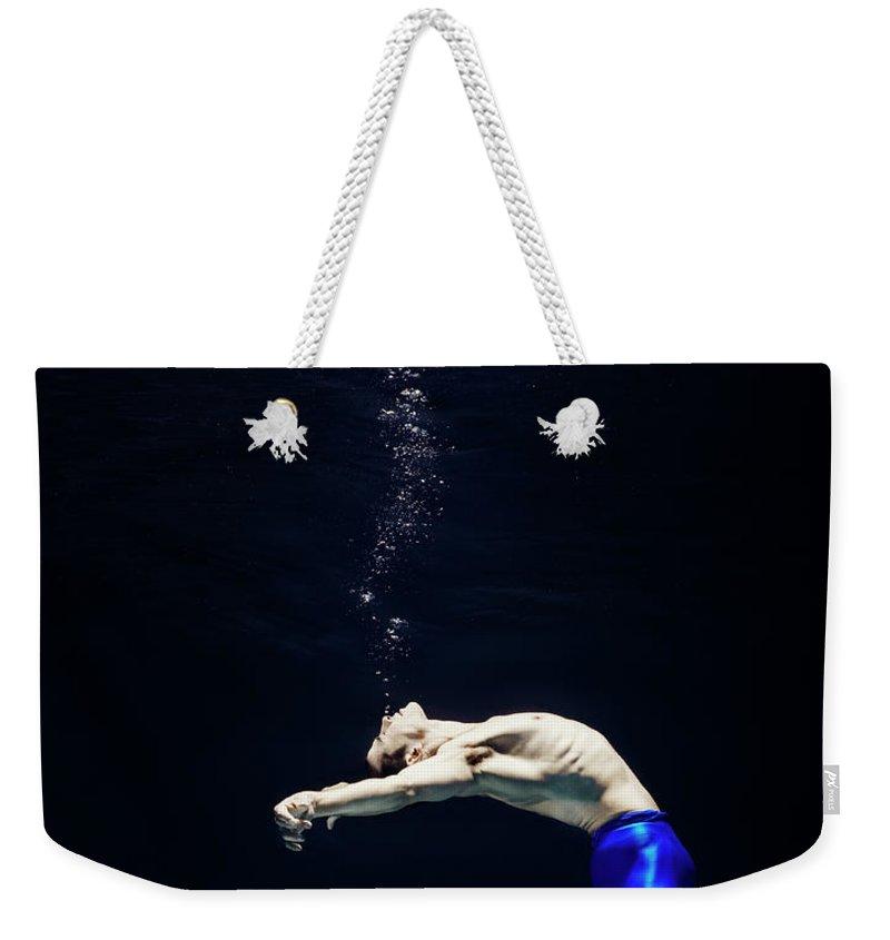 Ballet Dancer Weekender Tote Bag featuring the photograph Ballet Dancer Underwater by Henrik Sorensen