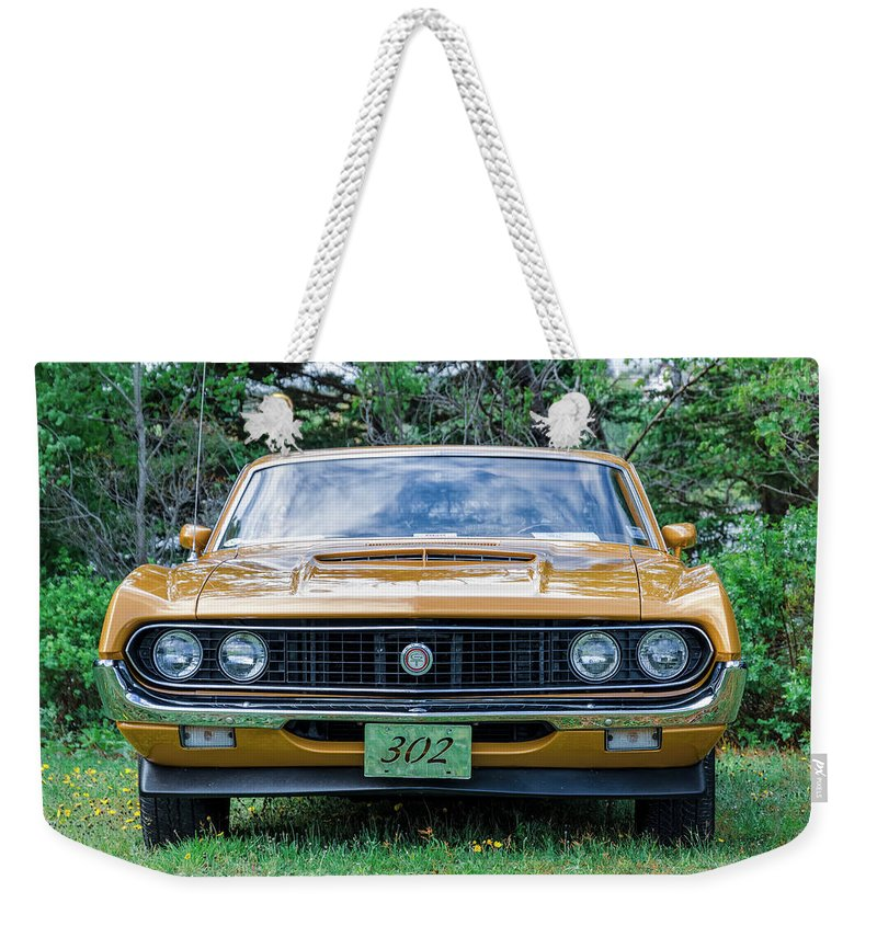 1970 Weekender Tote Bag featuring the photograph 1970 Ford Torino Gt by Ken Morris