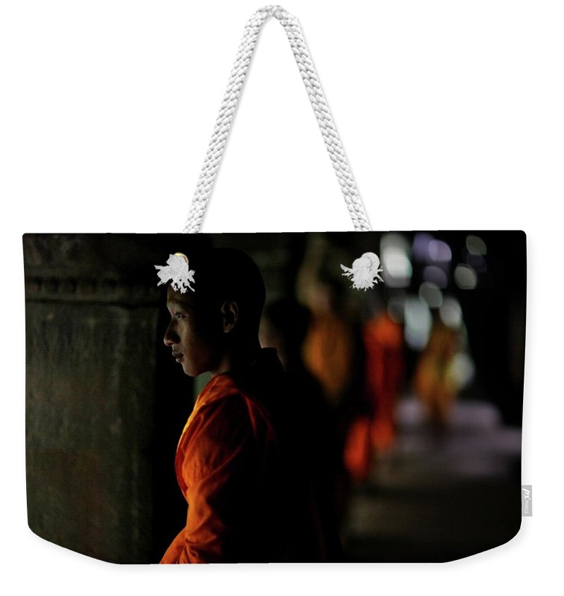 People Weekender Tote Bag featuring the photograph Buddhist Monks At Angkor Wat Temple by Timothy Allen